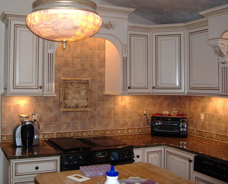 Kitchen cabinets and range hood wood species maple door for Antique white finish kitchen cabinets