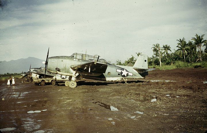 TBM-1C Avengers and an F4F Wildcat probably with Marine squadrons lined up at Dulag airstrip Leyte Philippines c. 1944.