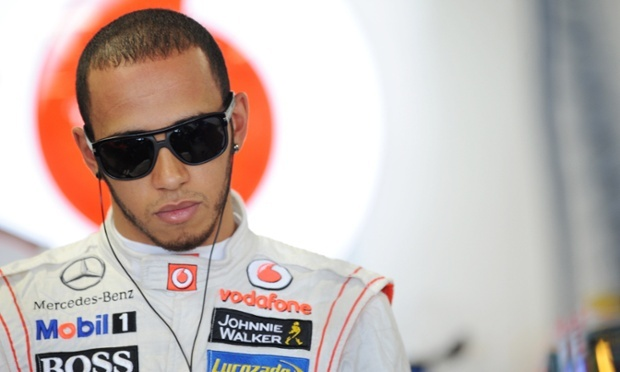 Deep in thought: Lewis Hamilton ahead of the Japanese Grand Prix practice. Photograph: Crispin Thruston/Action Images  ~1eyeJACK~
