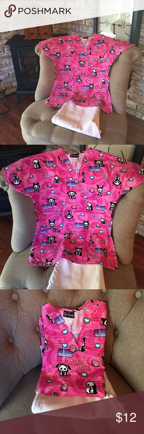 Skelanimals medical scrub uniform top and pants xs Who says scrubs have to be plain and boring!!! Adorable skelanimals hot pink medical scrub top size xs throwing in white pants for a set. skelanimals Other