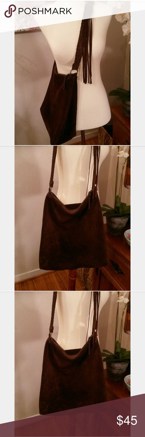 Gap Brown Suede Fringed Bag Gap boho style brown suede bag.  *adjustable braided suede strap.  *inner side zip pocket *brass hardware *zipper has one fringe strand missing,  but not noticeable when wearing. *may be worn crossbody  * Suede has normal minor signs of wear. *very good used condition  Smoke free home. Posh ambassador. Gap Bags