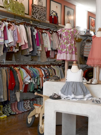 Shoes under clothes, display shelf above in coordinating color. Need to check this out - Luca Children's Consignment in Warren