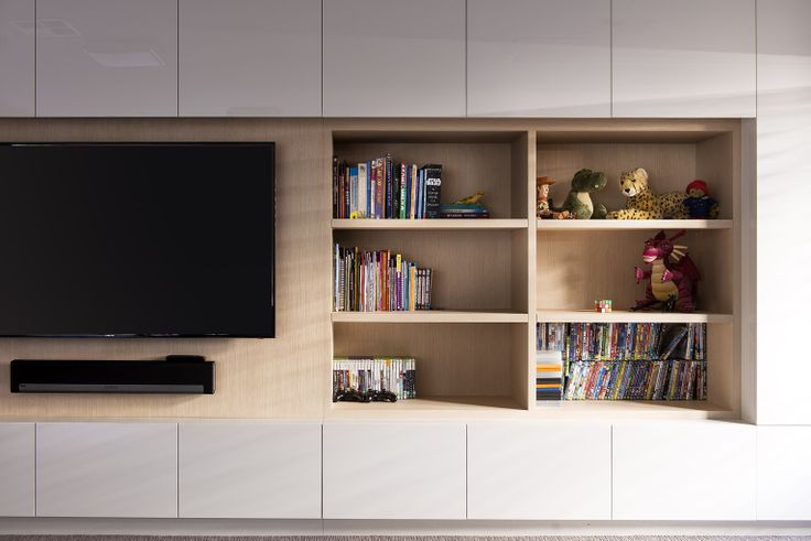 Great storage solution - open shelving and lots of cupboards for a children's games room designed by Urbane Projects.