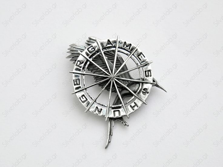 https://www.etsy.com/listing/151164873/hunger-games-mockingjay-pendant-katnissThis replica pendant is handcrafted and also available as a pin on request.