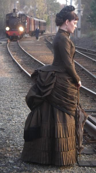 """""""1878 - 1890 Victorian.""""  This looks like a modern-day movie costume (for Anna Karenina maybe? Oogh, that train), and I think the date may be off, because the bustle looks like the earlier style. Again, not mourning, but close."""