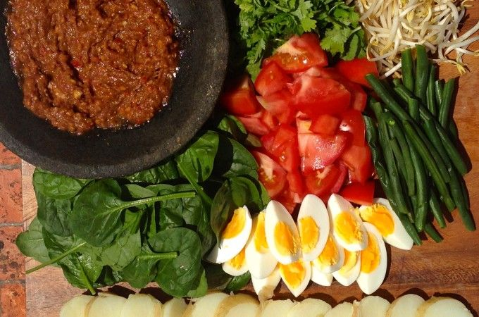Gado Gado board   Author: Vanessa Recipe type: Salad Cuisine: Indonesian Serves: 4 Prep time: 10 mins Cook time: 20 mins Total time: 30 mins Save Print   Love love love this salad from my 6 years living in Indonesia.
