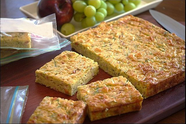Zucchini and cheese with bacon cubes