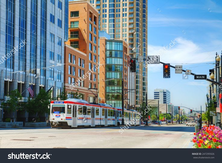 SALT LAKE CITY - May 2: Street overview with a tram on May 2, 2014 in Salt Lake City, Utah. SAlt Lake is the capital and the most populous city in the state of Utah.