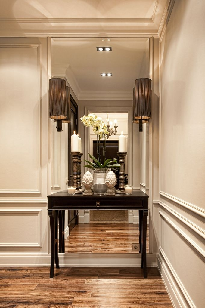 mirrored wall behind console table