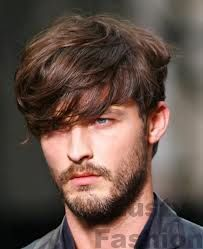 Another trend with the Long fringe, short back and sides, is also a trimmed light beard, that gives a more manly appearance.