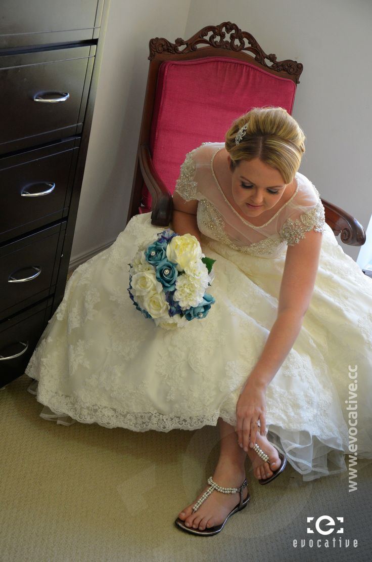 Alison the bride adjusting her shoes before heading to the wedding ceremony. #WeddingPhotography
