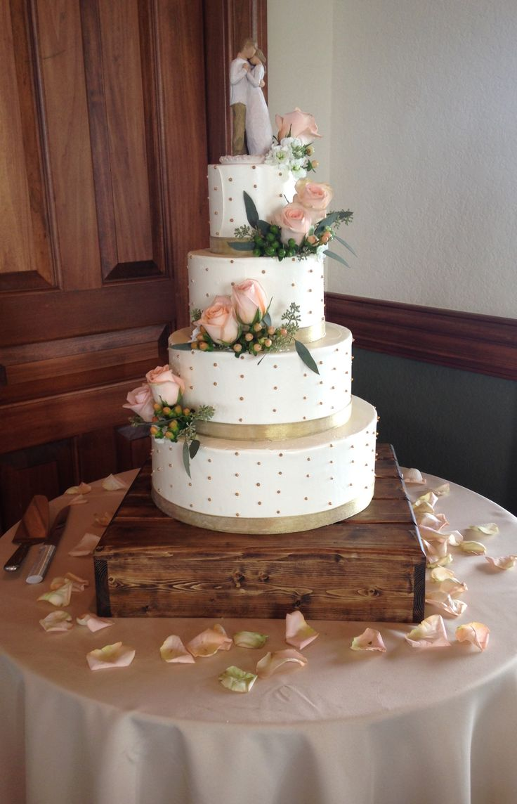 Simple buttercream wedding cake accented the gold