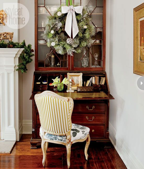 This antique Queen Anne-style secretaire acts as display space for a holiday living room vignette. @Karen Jacot Darling at Home