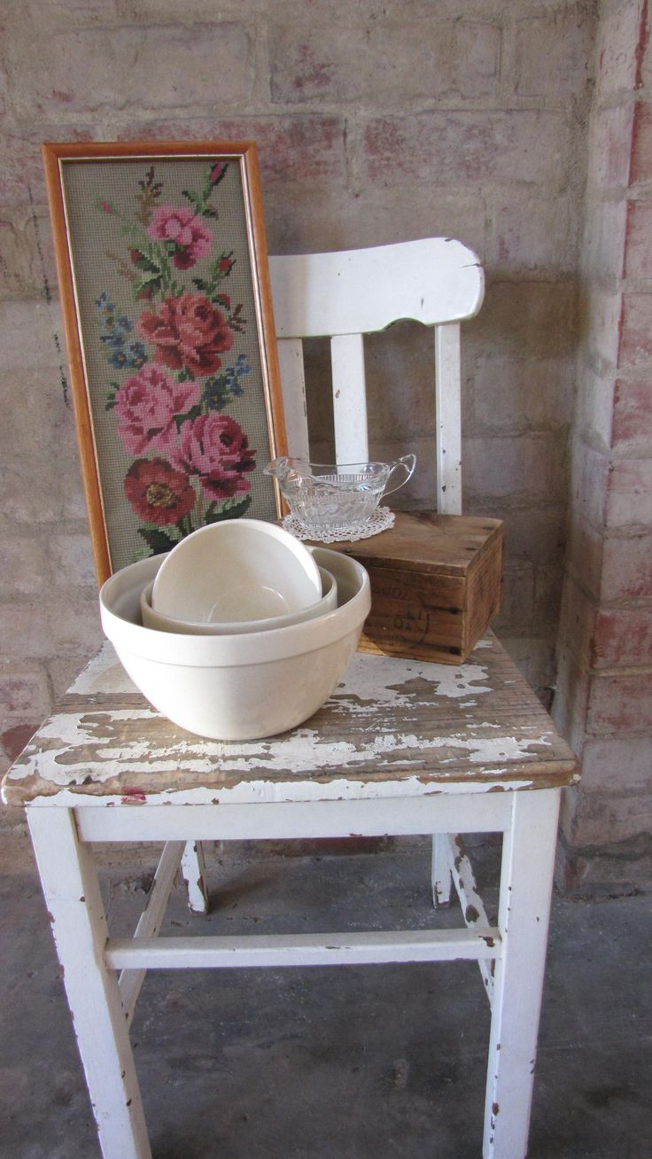Vintage styling: rose tapestry, chippy chair, and mixing bowls.   https://www.facebook.com/pages/Rubys-and-Pearls/744861835533003