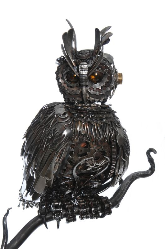 Wilhelm Eagle Owl by Alan Williams  Cutlery, Motorbike and bicycle parts. Mounted on a 5ft solid oak plinth.  53cm top to tail