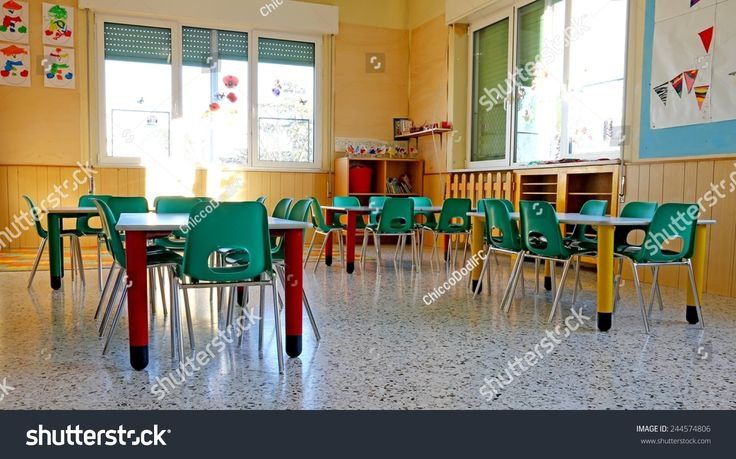 kindergarten with green chairs and tables