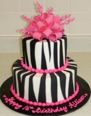 Zebra Print Cake - A buttercream iced cake with black fondant zebra stripes and a gumpaste bow.