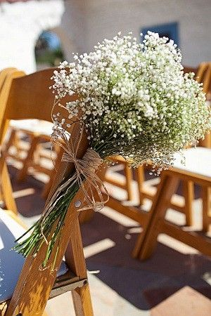 Aisle decor - baby's breath.. Probably use less, and maybe have a colorful ribbon holding them together?