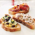 Bruschetta with Assorted Toppings    A single baguette, sliced and used as a foundation, yields a host of easy-to-assemble appetizers. Prepare toppings the day before and add them just before serving. Offer guests small plates and forks to scoop up the extras.