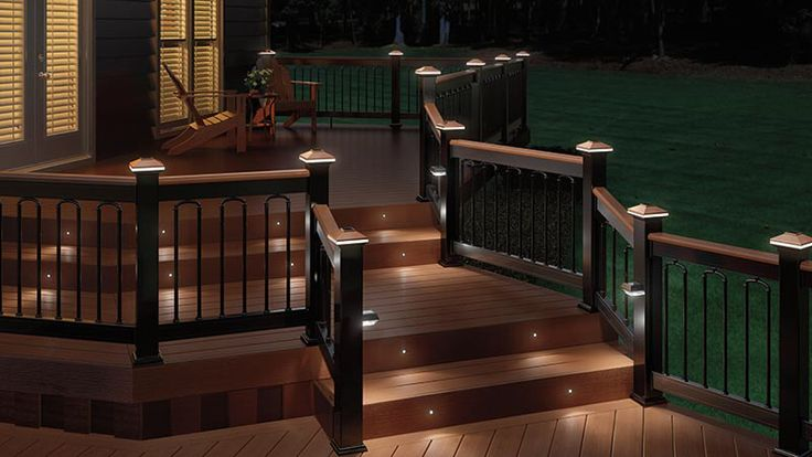 Black Aluminum railing with tropical hardwood cap rail, black Classic balusters with Arched Duo Connectors, black Solar Post and Stair Lights, copper Solarband post caps and Recessed Lighting Kit