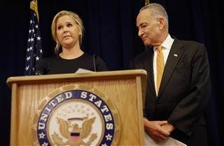 Image: Actress Amy Schumer becomes emotional during a news conference while her distant cousin, New York Sen. Chuck Schumer