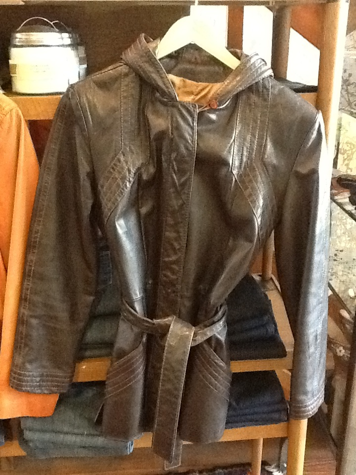 Dark brown leather jacket, with hood. Women's size small $72
