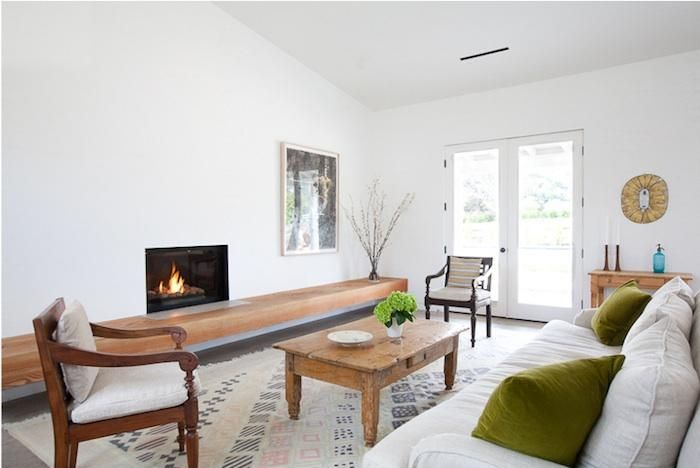 fantastic wood hearth/bench along the fireplace via remodelista. Add drawers under bench for storage!