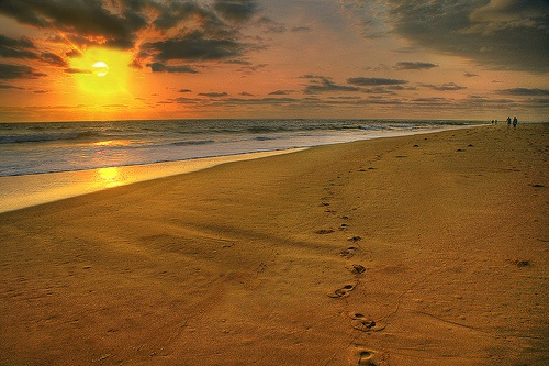 footprints in the sand on a deserted Mozambique beach makes for a surreal sunrise!