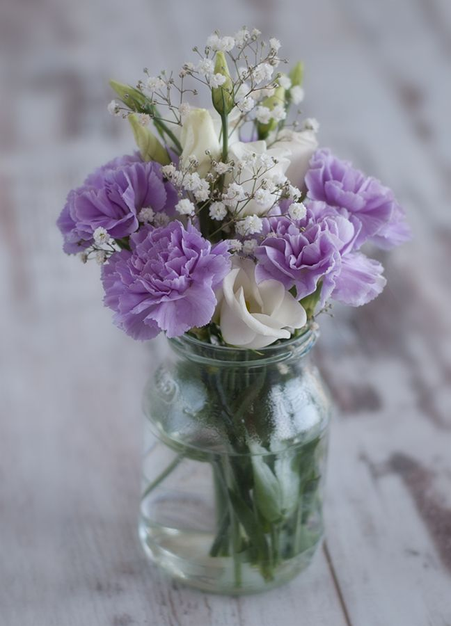 Several multicolored carnation w/ baby's breath mason jar arrangements would be lovely for my bridal shower.