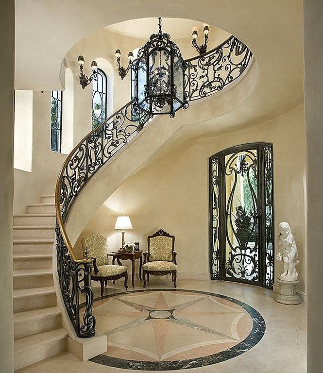 Wrought Iron Staircase: Mediterranean Staircase With Wall Sconce, Concrete Floors
