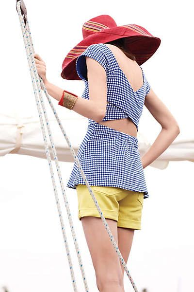 Anthropologie - Neo-Gingham Top.  I have the black and white one, I wear a camisole underneath to hide my lower back.