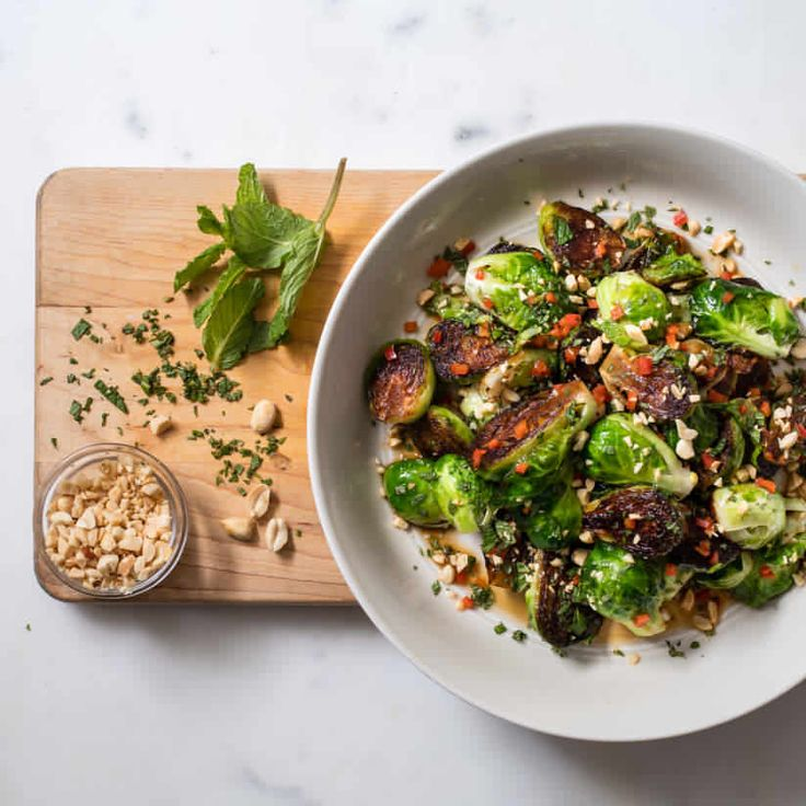 Skillet-Roasted Brussels Sprouts with Chile, Peanuts, and Mint | America's T…  – Yum!