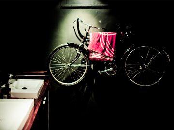 Craft Tratorria toilets. dramatic black walls. Bicycle towel rack.