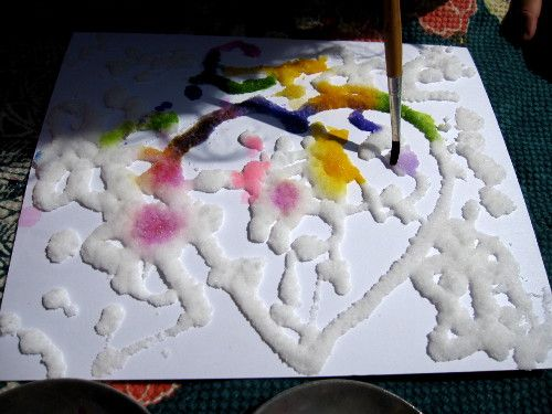 Draw design with glue, cover with salt. When dry, paint with watercolors.