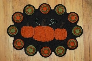 Pumpkin penny rug