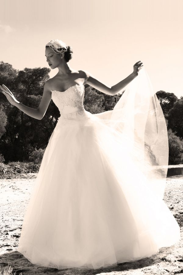White princess line gown with a tulle skirt and a satin waist belt combined with guipure lace