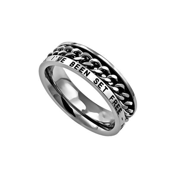 "Women's Freedom Ring Petite high-polished stainless steel Christian ring with chain center that spins. Width is 5mm. Band reads: ""My Chains Are Gone, I've Been"