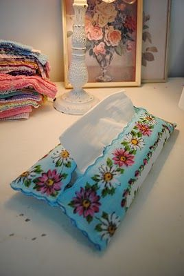 Tissue holder out of a handkerchief - ridiculously easy!  I wish I had seen this while Mom was still with us...she'd have loved it!