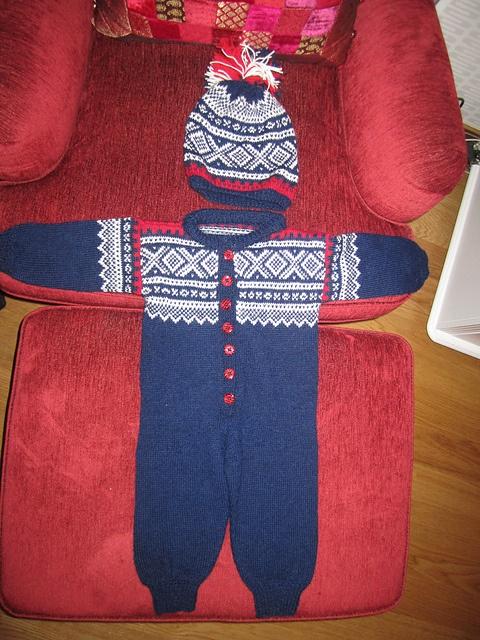 Marius body suit (hel dress) and hat for my grandchild  http://www.ravelry.com/projects/linost/nr-5-marius---hel-dress-sisu