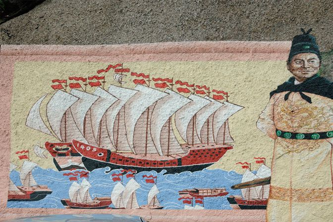 In the 15th century, Zheng He, seen here with one of his massive ships in a painting at a temple shrine in Malaysia, led seven enormous seafaring expeditions.Photo credit: © Chris Hellier/Corbis
