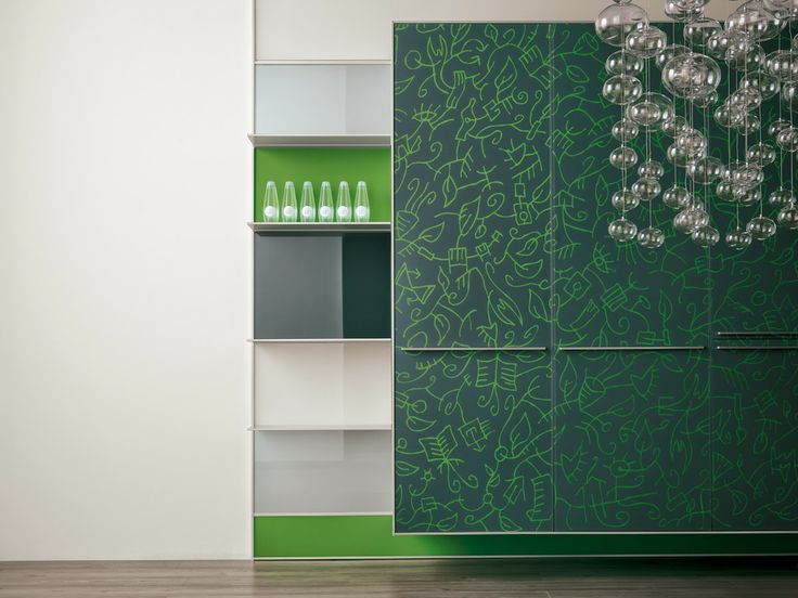 a detail of an Arte kitchen from Valcucine, with custom artwork on the cabinets