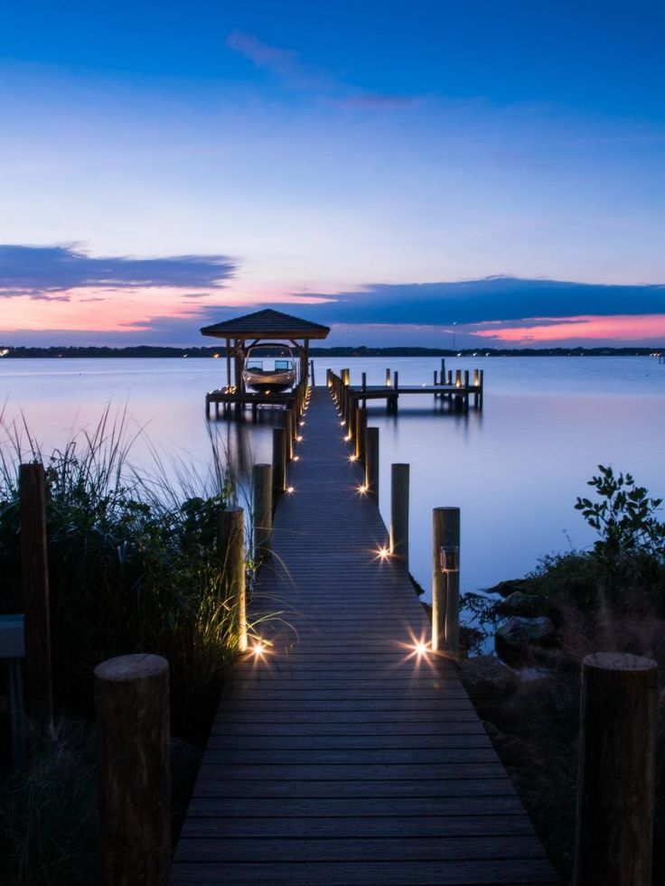 Even at night, the dock is inviting allowing guests to venture out safely. Button lights sunken into the boards illuminate the way.