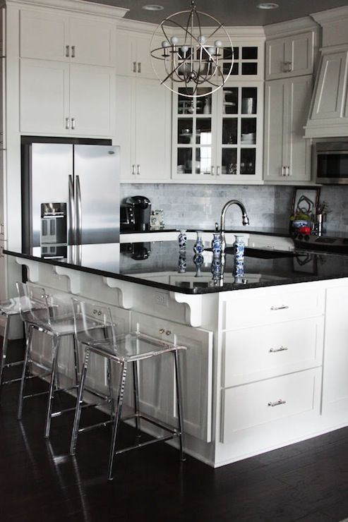 Black Granite Countertops And White Shaker Style Ceiling