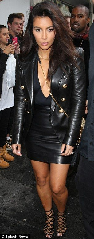 Back in black: The Keeping Up With The Kardashians star turned heads in an all-black leath...