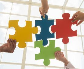 picture of team - Group of business people assembling jigsaw puzzle and represent team support and help concept - JPG