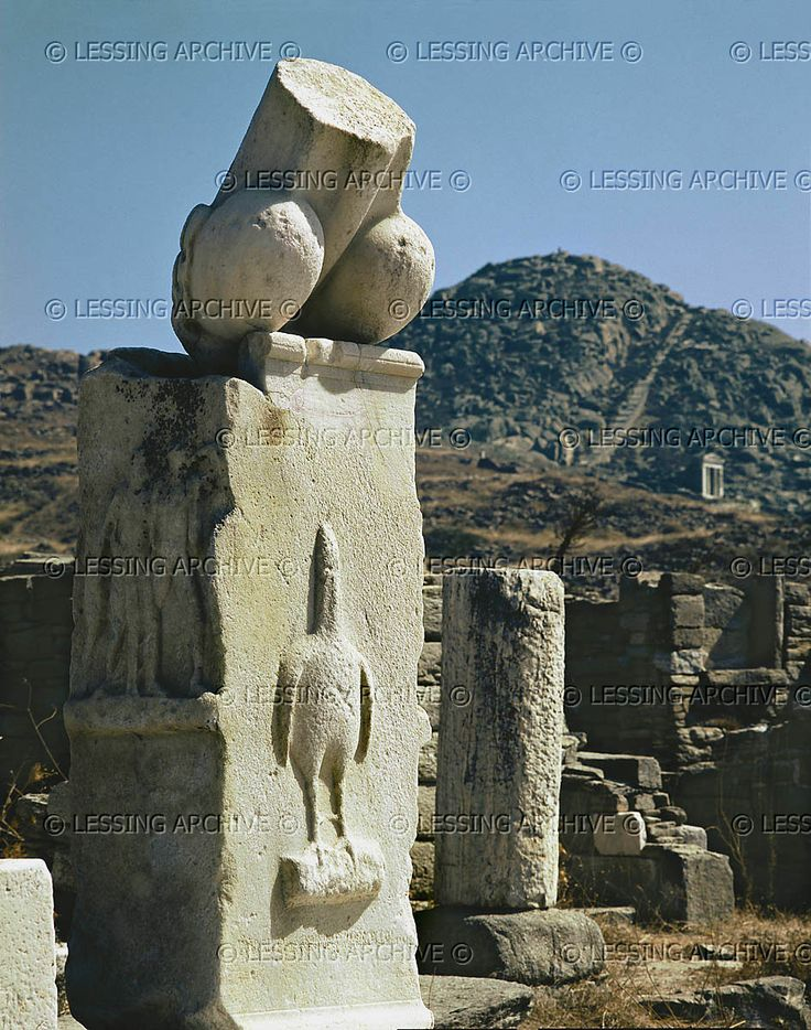 Hahahahhaa is that a decapitated chicken below that penis statue?  Dionysos sanctuary, Delos, monumental phallus with a relief of the phallus-bird, a symbol of the God, carried in procession or drawn on a chariot during Dionysian rites. Inscription says monuments were donated by Karystos, son of Asbelos. Around 300 BCE   Archaeological Site, Delos, Greece