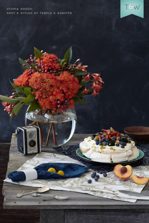 Utopia Goods table linen for Australia Day, with flowering gum and a pavlova.