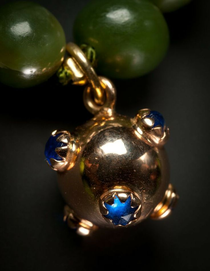 old jade bracelet with small ball magnate