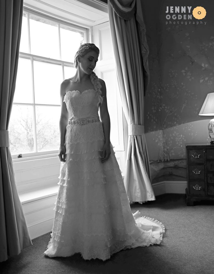 The bride before the ceremony in the bedroom