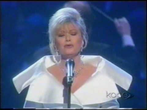 """Don't Cry for Me Argentina, Elaine Paige  If you are homesick and your home is a 4 syllable word like California, Oklahoma or can be converted into a 4 syllable word to replace """"Argentina"""" you now have a song you can sing to yourself."""